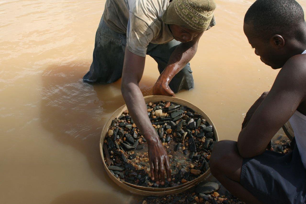 Alluvial Diamond Mining in River